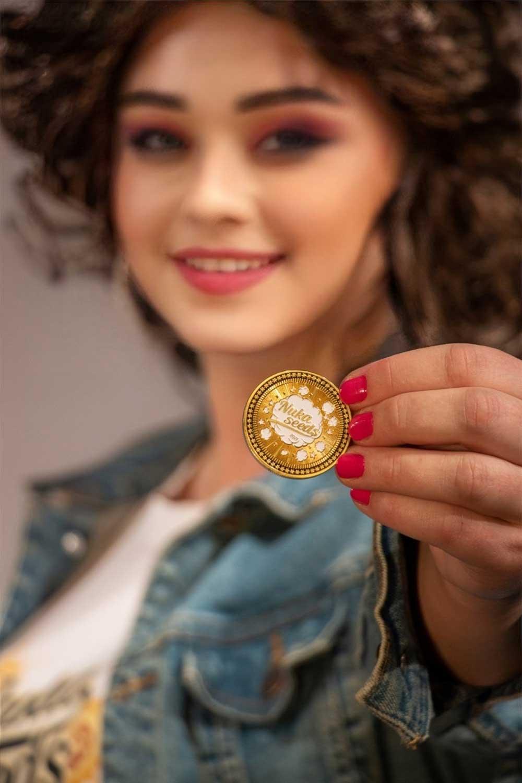 Nuka seeds coin with a girl